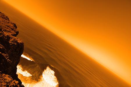 vast: Beautiful deserted planet with vast ocean in orange colors Stock Photo