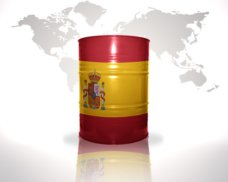 heavy fuel: barrel with spanish flag on the world map background