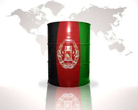 barrel with afghan flag on the world map background photo