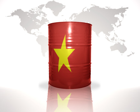 fuel provider: barrel with vietnamese flag on the world map background Stock Photo