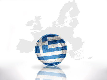 euro coin with greek flag on the european union map background photo