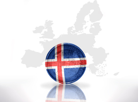 the icelandic flag: euro coin with icelandic flag on the european union map background