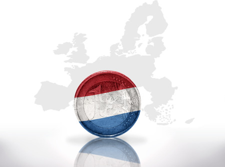 euro coin with dutch flag on the european union map background photo