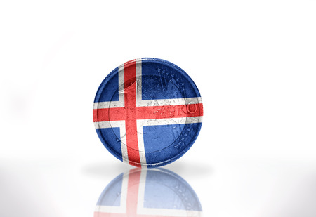icelandic flag: euro coin with icelandic flag on the white background