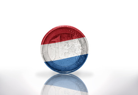 euro coin with dutch flag on the white background photo
