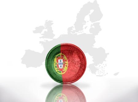 international crisis: euro coin with portuguese flag on the european union map background Stock Photo