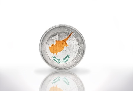 international crisis: euro coin with cypriot flag on the white background