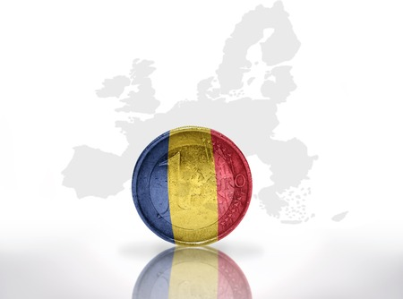 international crisis: euro coin with romanian flag on the european union map background