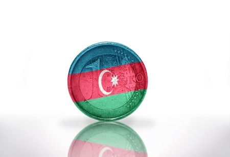 international crisis: euro coin with azerbaijani flag on the white background Stock Photo