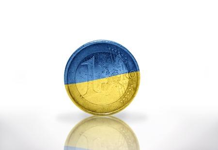 euro coin with ukrainian flag on the white background photo
