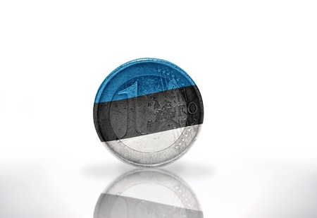 estonian: euro coin with estonian flag on the white background