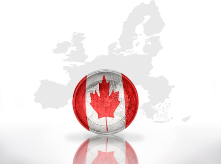 canadian coin: euro coin with canadian flag on the european union map background