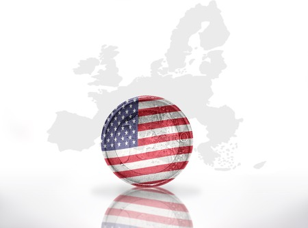 euro coin with american flag on the european union map background photo