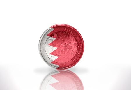 bahrain money: euro coin with bahrain flag on the white background