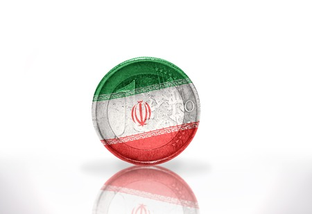 middle east crisis: euro coin with iranian flag on the white background