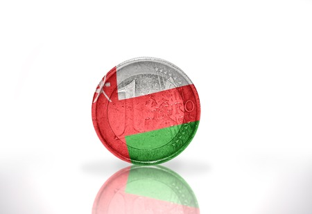 oman background: euro coin with oman flag on the white background Stock Photo