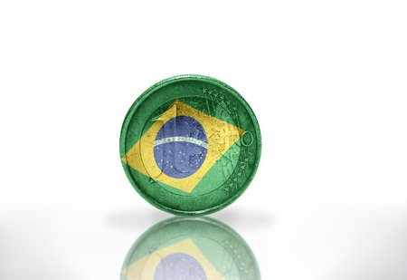 euro coin with brazilian flag on the white background photo