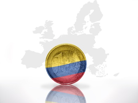 colombian: euro coin with colombian flag on the european union map background