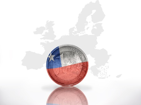 chilean flag: euro coin with chilean flag on the european union map background
