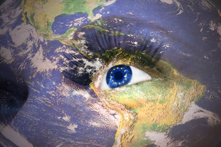 Womans face with planet Earth texture and european union flag inside the eye.  photo