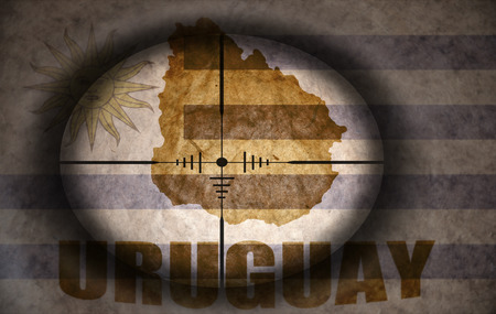 uruguay flag: sniper scope aimed at the vintage uruguay flag and map Stock Photo