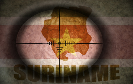 scope: sniper scope aimed at the vintage surinam flag and map