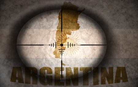 scope: sniper scope aimed at the vintage argentina flag and map Stock Photo