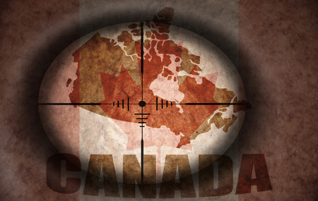 scope: sniper scope aimed at the vintage canada flag and map