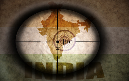 scope: sniper scope aimed at the vintage india flag and map