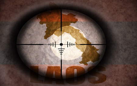 laotian: sniper scope aimed at the vintage laos flag and map Stock Photo