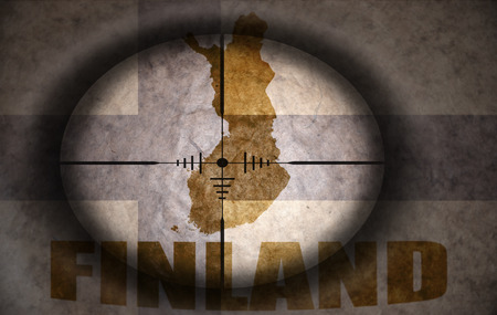 scope: sniper scope aimed at the vintage finland flag and map