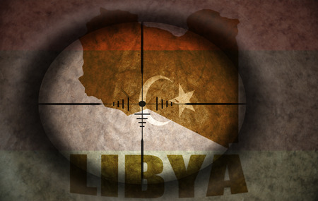 libyan: sniper scope aimed at the vintage libyan flag and map