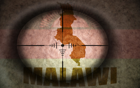 malawi flag: sniper scope aimed at the vintage malawi flag and map Stock Photo