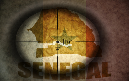 senegalese: sniper scope aimed at the vintage senegalese flag and map