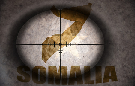 somali: sniper scope aimed at the vintage somalia flag and map