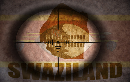 scope: sniper scope aimed at the vintage swaziland flag and map