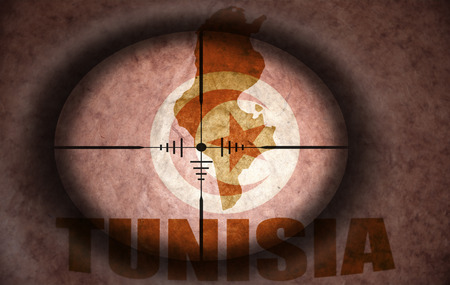 scope: sniper scope aimed at the vintage tunisian flag and map Stock Photo