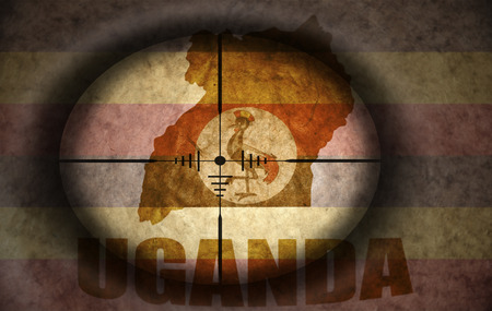 ugandan: sniper scope aimed at the vintage ugandan flag and map