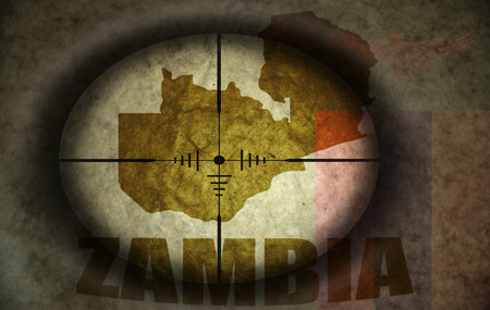 zambian flag: sniper scope aimed at the vintage zambian flag and map