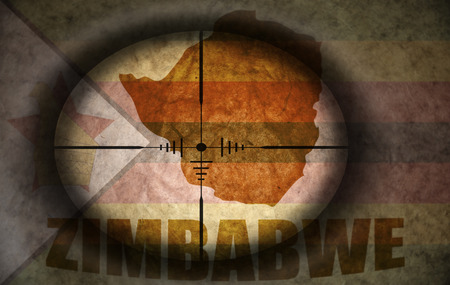 scope: sniper scope aimed at the vintage zimbabwean flag and map