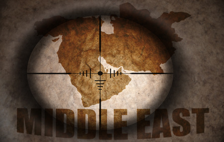middle east map: sniper scope aimed at the vintage middle east map Stock Photo