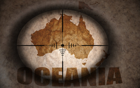 oceania: sniper scope aimed at the vintage oceania map Stock Photo