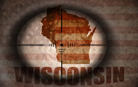 wisconsin state: sniper scope aimed at the vintage american flag and wisconsin state map