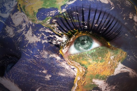 womans face with planet Earth texture and american banknote inside the eye.  photo
