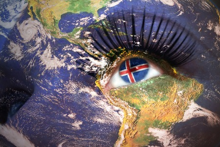 icelandic flag: womans face with planet Earth texture and icelandic flag inside the eye.