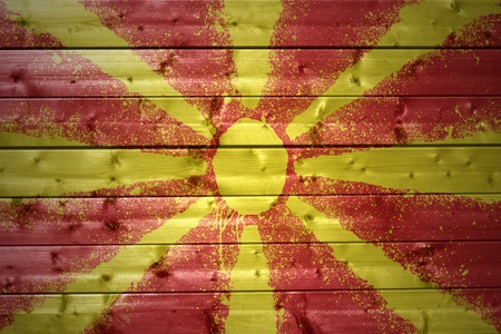macedonian flag: colorful painted macedonian flag on a wooden texture