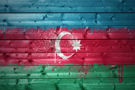 azerbaijani: colorful painted azerbaijani flag on a wooden texture