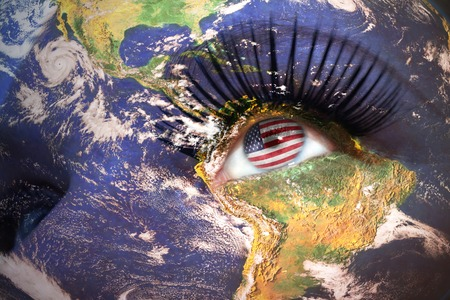 us sizes: womans face with planet Earth texture and american flag inside the eye.
