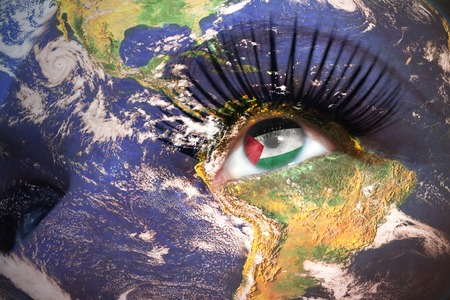 palestinian: womans face with planet Earth texture and palestinian flag inside the eye.