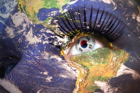 korean flag: womans face with planet Earth texture and korean flag inside the eye.